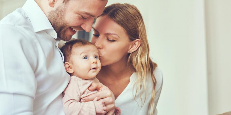 Happy Young Couple with Baby
